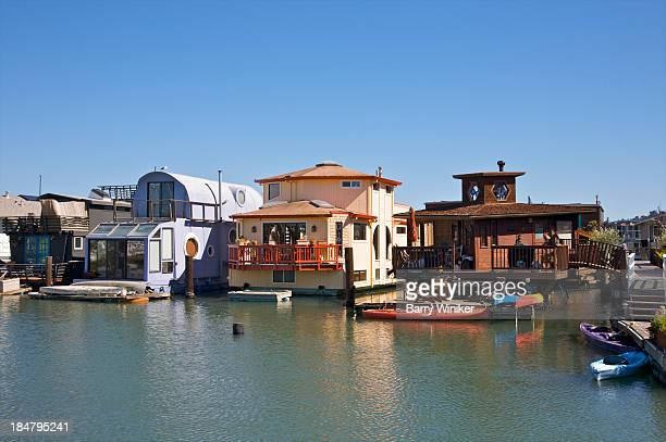Unusual floating homes lined up on water