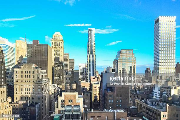 unusual new york cityscape, mid manhattan - midtown manhattan stock pictures, royalty-free photos & images