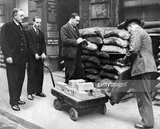 Unusual sight in Birmingham when half of ton of solid gold bars were transported from Messers Collie and Co commodity brokers of Newhall Street to...
