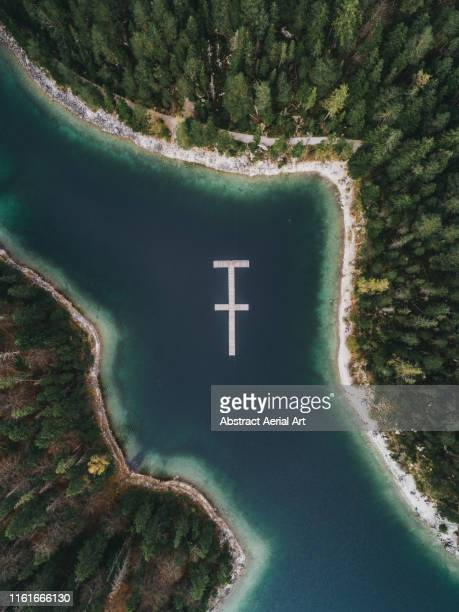 unusual structure floating in lake eibsee, bavaria, germany - the hobbit: an unexpected journey stock pictures, royalty-free photos & images