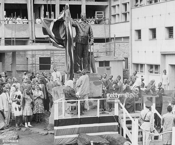 Unveils Leaders Statue Nairobi Kenya Kenya's vice president Oginga Odinga unveils statue of President Jomo Kenyatta here Kenyatta stands at right At...