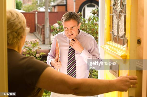 unwelcome salesman - old ugly woman stock photos and pictures