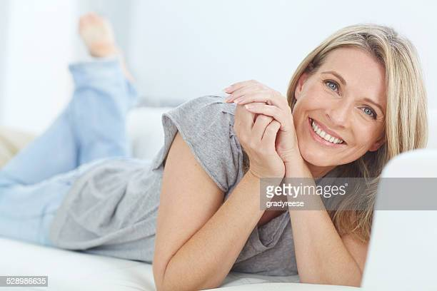 unwinding at home - pretty older women stock pictures, royalty-free photos & images