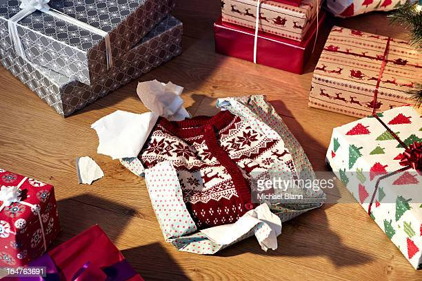 Unwrapped christmas jumper and gifts