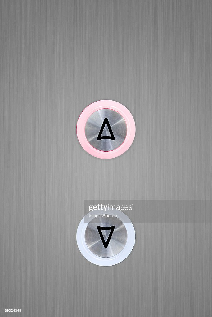 Up and down elevator buttons with up button lit up : Stock Photo