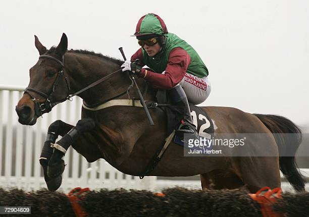 Up At Midnight and Paddy Merrigan in action during The Press Red To Bet On ATR Handicap Hurdle Race run at Ascot Racecourse on December 30 in Ascot,...