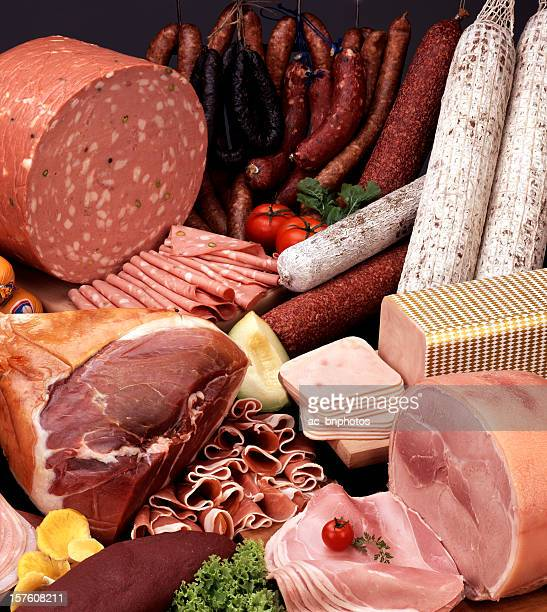 up close photo of assortment of cold cut meats - salumeria stock photos and pictures