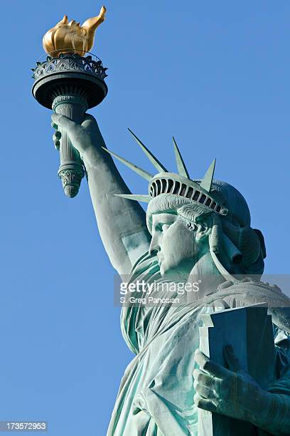 up close photo of the statue of liberty in new york city - statue of liberty stock pictures, royalty-free photos & images