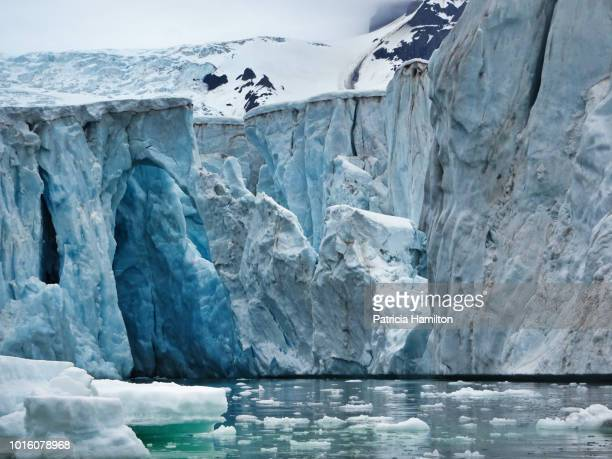 up close to a crumbling glacier terminal, greenland - pack ice stock pictures, royalty-free photos & images
