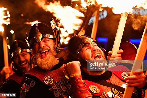 Up Helly Aa Vikings take part during a torchlight procession through Edinburgh for the start of the Hogmanay celebrations on December 30 2016 in...