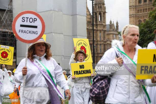 Up to a hundred women from the Lancashire antifracking movement dressed as suffragettes congregate in Parliament Square and pay the Dep For Energy...