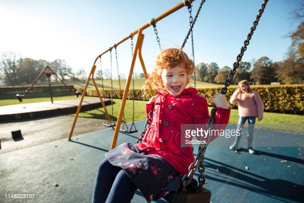 up, up and away! - britain playgrounds stock pictures, royalty-free photos & images