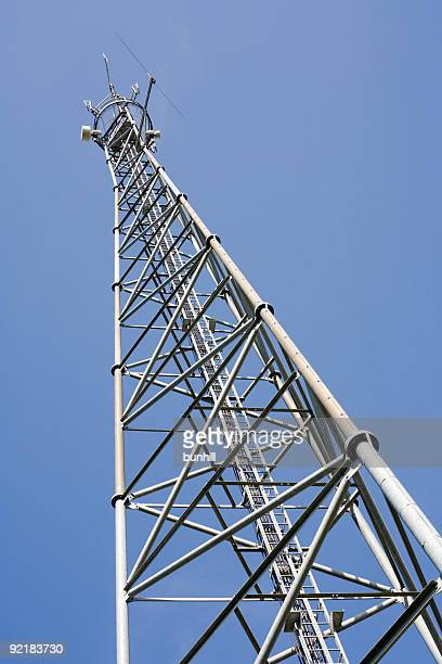 Up view of a communications tower against blue sky