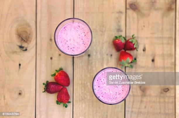 Up view of a tasty strawberry milkshake