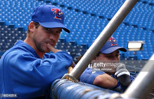 Toronto Blue Jays Catcher Ken Huckaby and Starter Chris Carpenter look concerned at the back of the batting cage before the last game before the MLB...