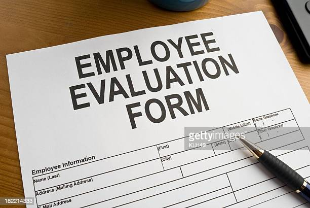 Up-Close shot of Employee Evaluation Form sheet and a pen