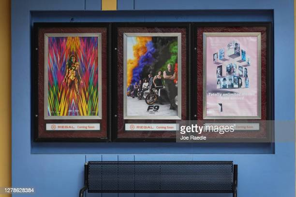 Upcoming movie posters are seen on the walls of a Regal Cinemas location on October 05, 2020 in Kendall, Florida. The parent company of Regal Cinemas...