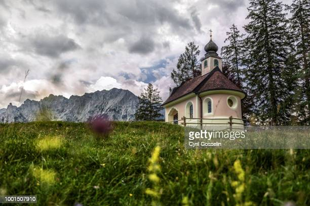 "upcoming storm over chapel ""maria königin"" - mittenwald stock pictures, royalty-free photos & images"