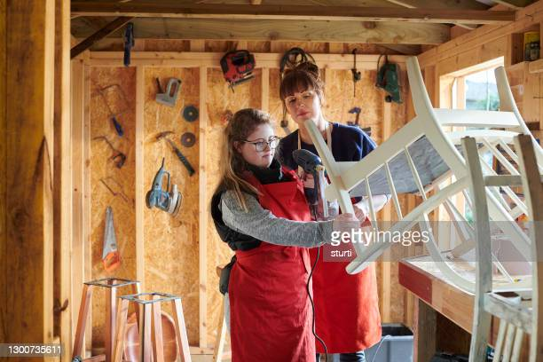 upcycling mother and daughter - furniture stock pictures, royalty-free photos & images