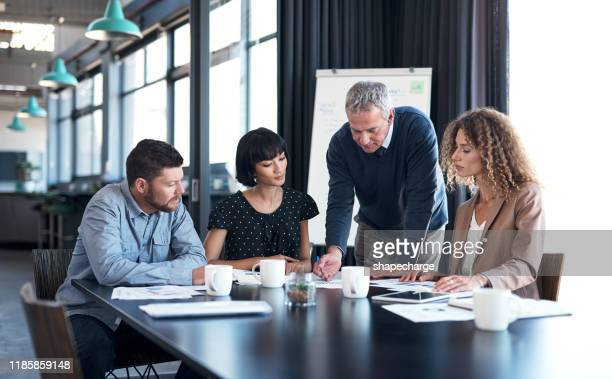 updating all on the latest business stats - business meeting stock pictures, royalty-free photos & images