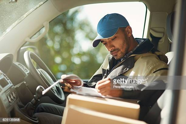 updating his delivery status - van stock pictures, royalty-free photos & images
