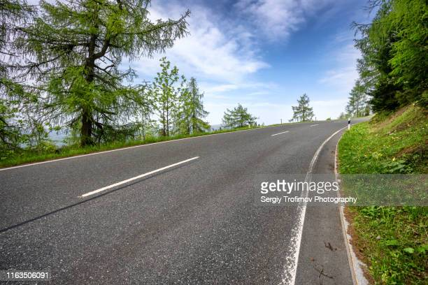 uphill road in mountains between austria and germany - uphill stock pictures, royalty-free photos & images