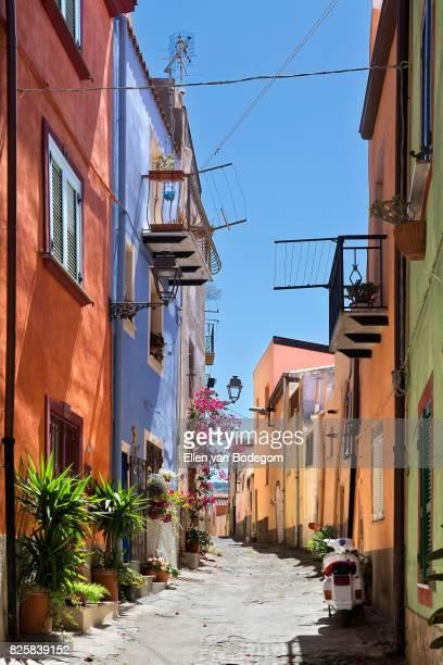 uphill street with colourful architecture in bosa, sardinia, on a sunny day - oristano imagens e fotografias de stock