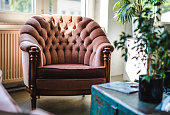 Upholstered Armchair and Trunk in Eclectic Office