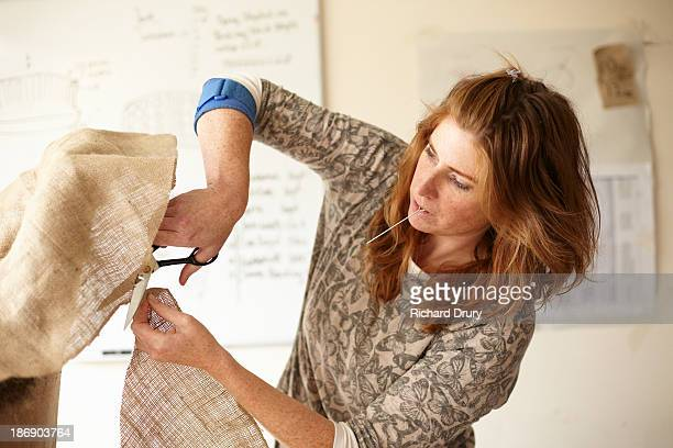 upholsterer cutting hessian to fit chair - richard drury stock pictures, royalty-free photos & images