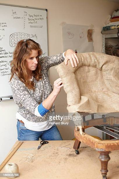 upholsterer fitting hessian to old chair - richard drury stock pictures, royalty-free photos & images