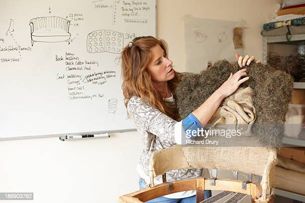 upholsterer fitting horse hair to old chair - richard drury stock pictures, royalty-free photos & images