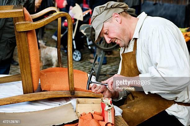 upholsterer showing traditional handcraft
