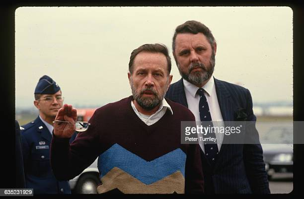Upon his arrival in Wiesbaden, David Jacobson stands with Terry Waite, who helped to negotiate his release from Lebanese terrorists in 1986. Waite...