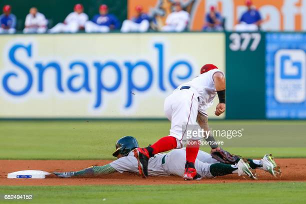 Upon official review Oakland Athletics Center field Rajai Davis is called out after being tagged by Texas Rangers Second base Rougned Odor during the...