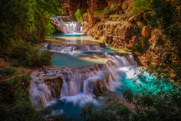 upon setting foot in this havasupai people land - beaver falls in havasu creek stock pictures, royalty-free photos & images