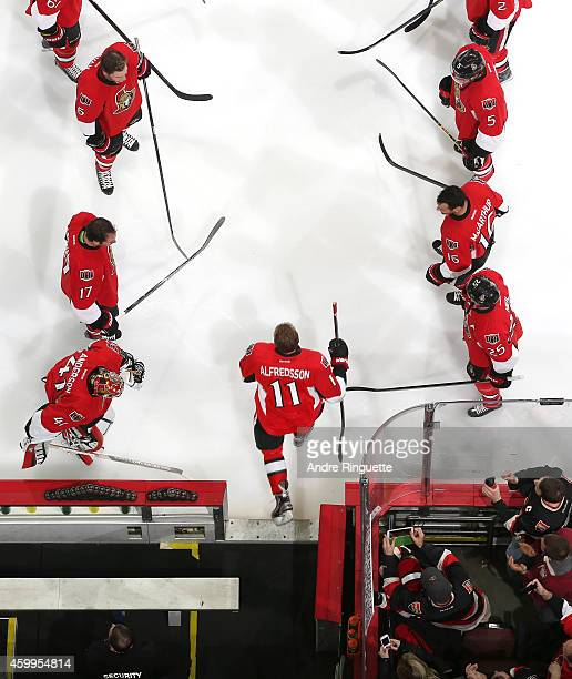 Upon signing a one day contract to retire with the NHL team he played 17 years with Daniel Alfredsson of the Ottawa Senators steps onto the ice for...