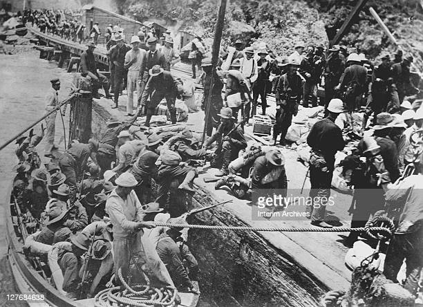 Upon the conclusion of the Spanish American War a view of American forces landing in small boats at Baguiri Cuba to begin two years of military...
