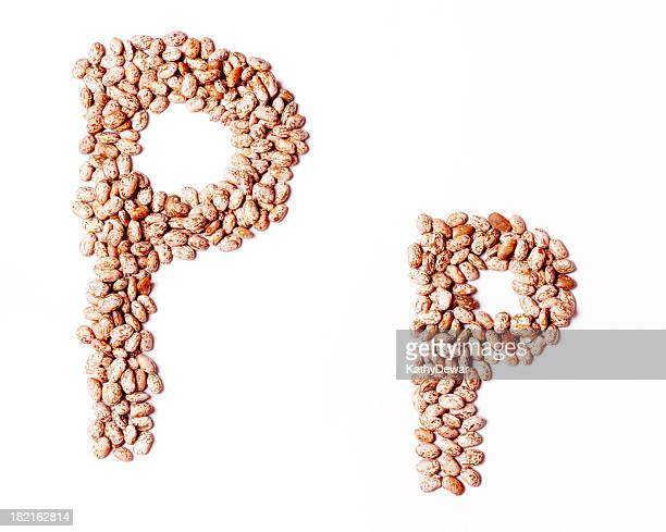 upper and lower case letter p made with pinto beans - pinto bean stock photos and pictures