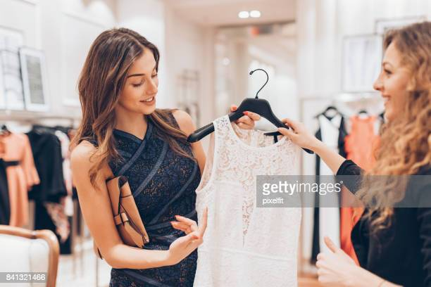 upper class woman choosing a new dress - lace dress stock pictures, royalty-free photos & images