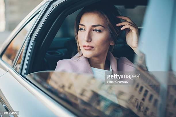 Upper class woman in a car