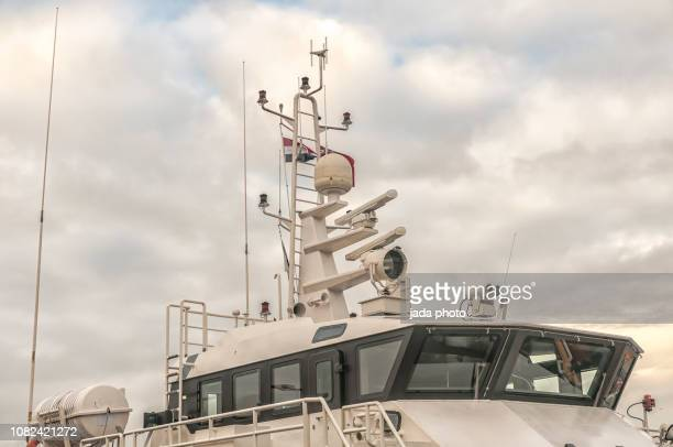 upper deck of a ship with radar installation - passagier wasserfahrzeug stock-fotos und bilder