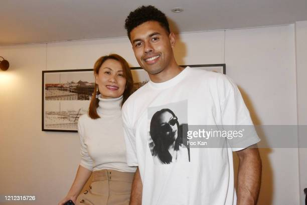 """Upper Gallery director Jacqueline Huang and Racing 92 rugby player Ben Volavola attend """"Babel"""" By L'Atelier Mad Exhibition Preview At Upper Gallery..."""