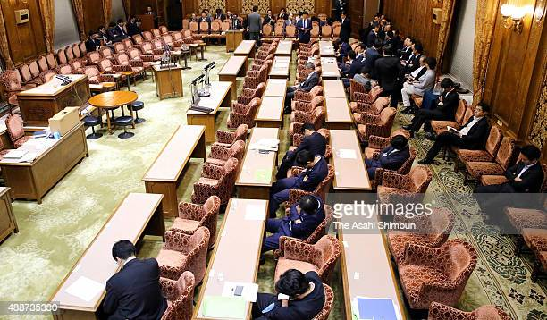Upper House lawmakers take nap as an Upper House special committee on the security legislation bills is suspended on September 17 2015 in Tokyo Japan...