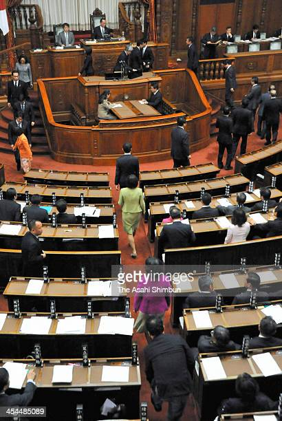 Upper House members of the ruling coalition vote to pass the state secrets protection bill while opposition party members boycotting at the diet...