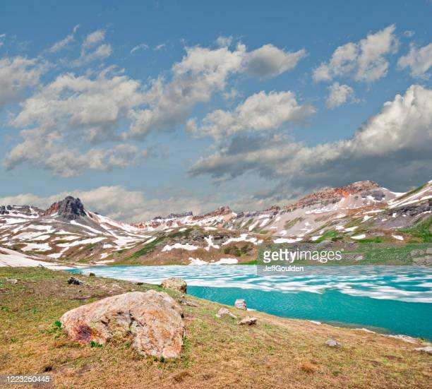 upper ice lake and surrounding peaks - jeff goulden stock pictures, royalty-free photos & images