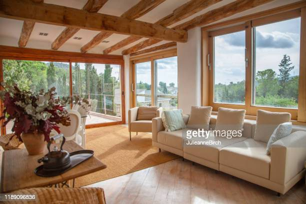 upper living room view on to garden, pool and courtyard of spanish farmhouse, barcelona - ceiling stock pictures, royalty-free photos & images
