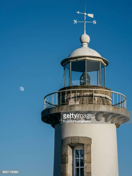Upper part of lighthouse and the moon