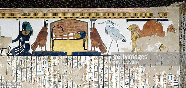 Upper register two lions with the symbol of Atum the god Bennu symbol of the soul of Ra the mummy of Nefertari protected by two falcons symbols of...