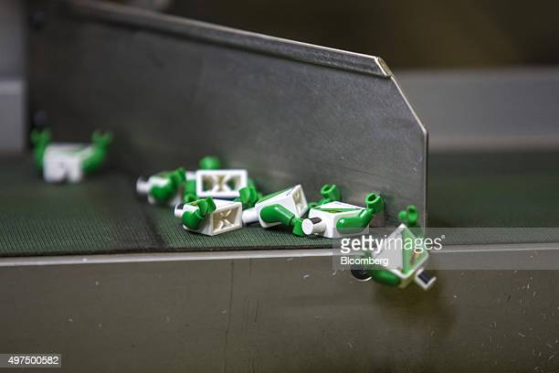 Upperbody parts of Lego figurines from the 'Lego City' collection move along the production line at the Lego A/S Factory in Kladno Czech Republic on...