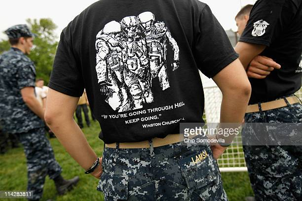 Upperclassmen from the United States Naval Academy wear tshirts quoting Winston Churchill as they instruct the freshman class during the rigorous Sea...